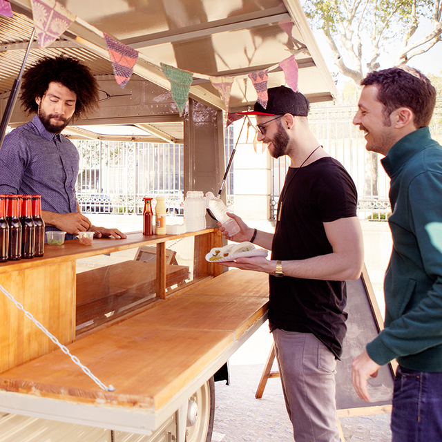 Men purchasing at a food truck