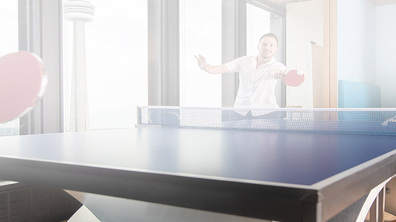 visa employee playing ping pong