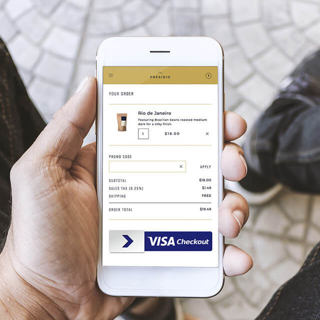 Close-up of phone using Visa Checkout