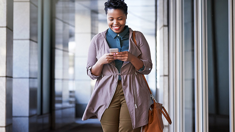 Woman smiling at a smart phone.