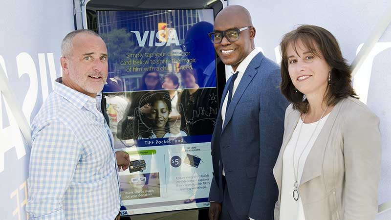 People using Visa's connected screen at TIFF
