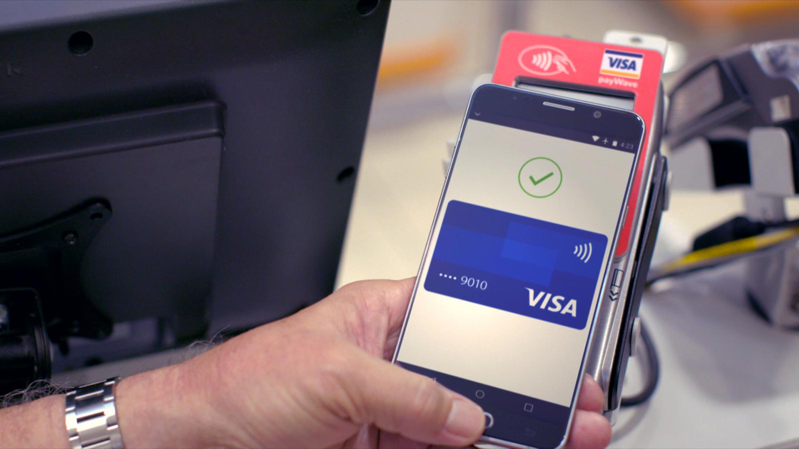 Payment being made with Visa payWave
