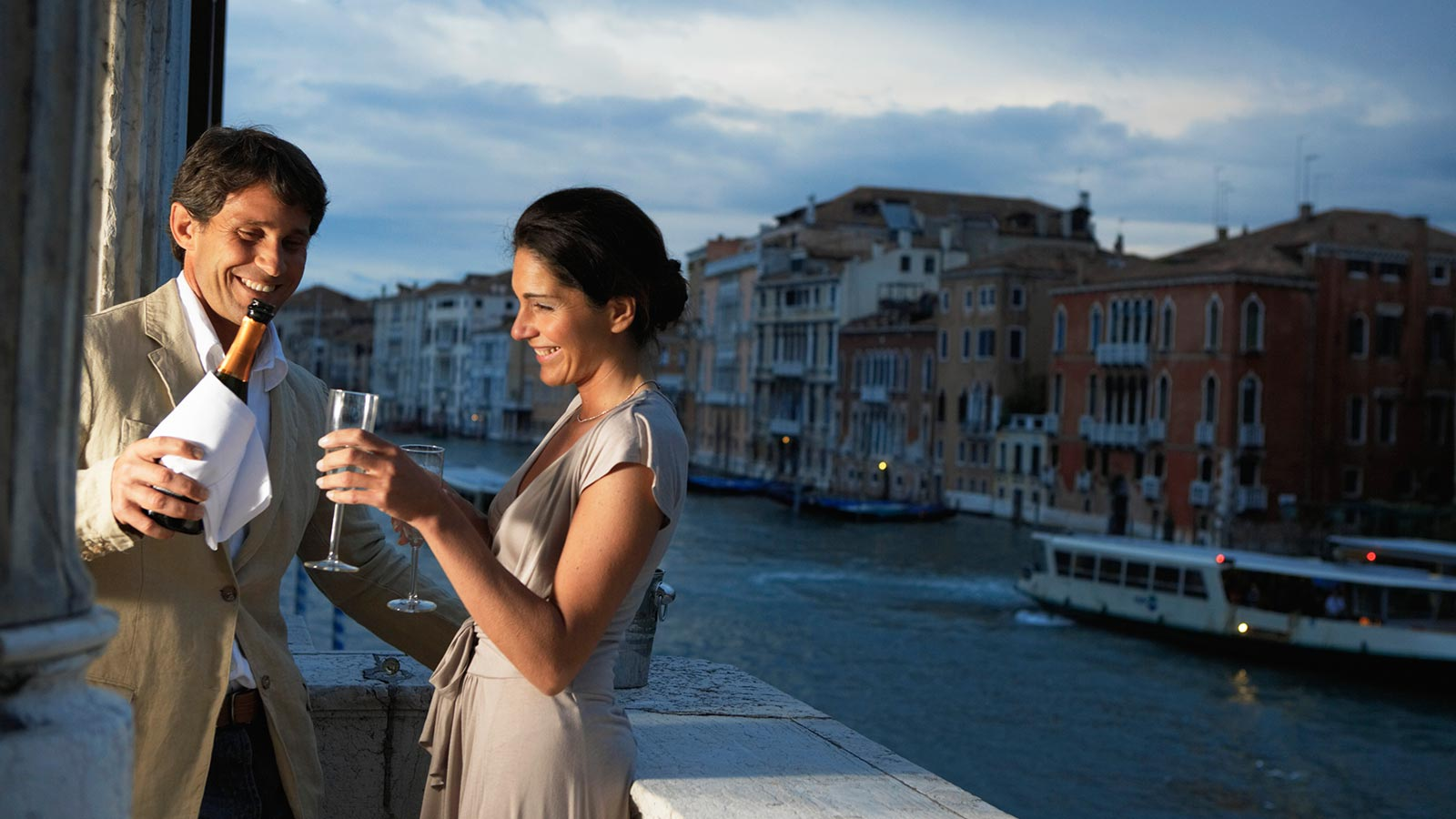 Man and woman drinking champage on balcony